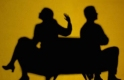 silhouette of arguing couple facing opposite directions